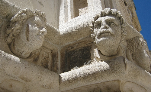 Carved heads on the exterior of Šibenik Cathedral © Ricky Yates