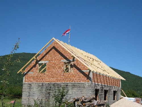 House being re-built in Gracac with prominent Croatian flag © Ricky Yates