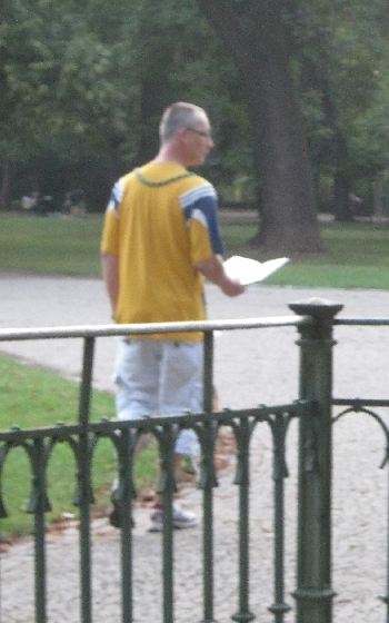 A man walking through Letna Park, reading a book © Ricky Yates