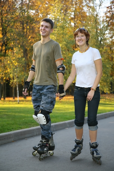 A happy couple roller blading