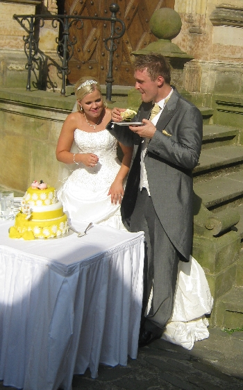 Daniel enjoying his wedding cake © Ricky Yates