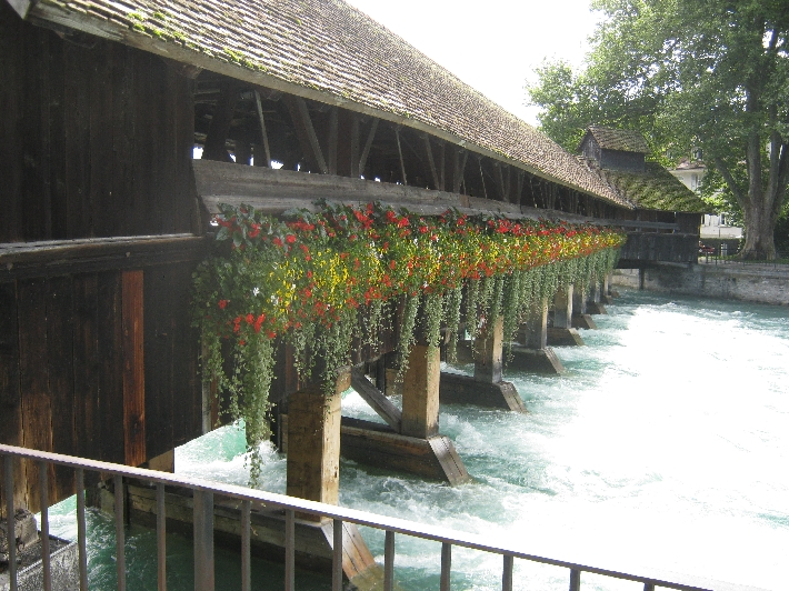 Covered bridge with floral decoration in Thun © Ricky Yates