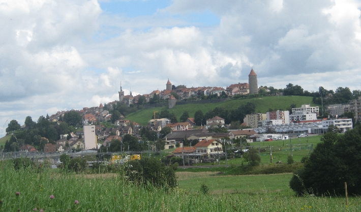 Historic hilltop town of Romont with modern development below © Ricky Yates