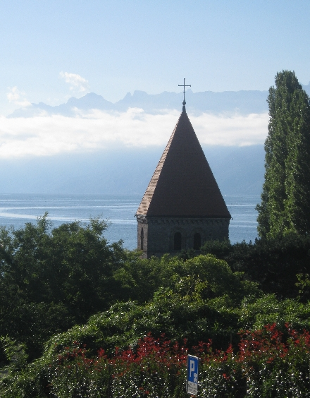 The tower of St-Sulpice Church with Lac Léman beyond © Ricky Yates