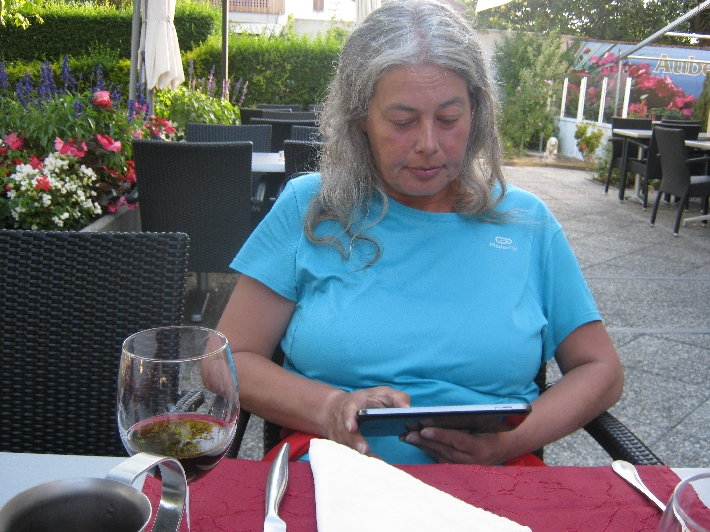 Sybille with her tablet & glass of red wine © Ricky Yates