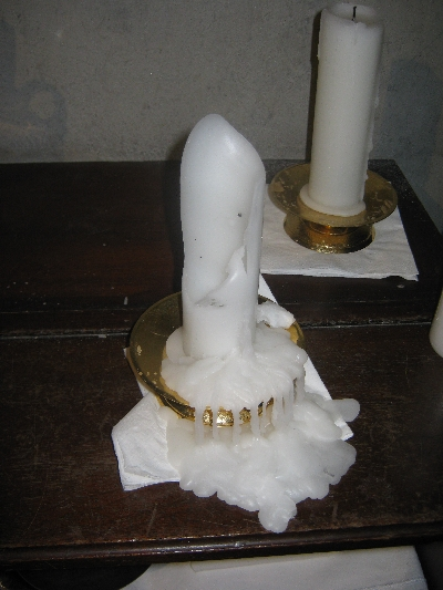 Imploded altar candle © Ricky Yates