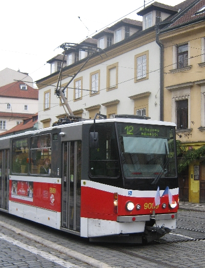 A Prague tram with two flags, celebrating a Czech public holiday © Ricky Yates