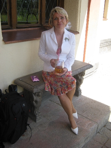 Zuzka enjoying her tea which was served to her in a Pilsner Urquell glass :-) © Ricky Yates