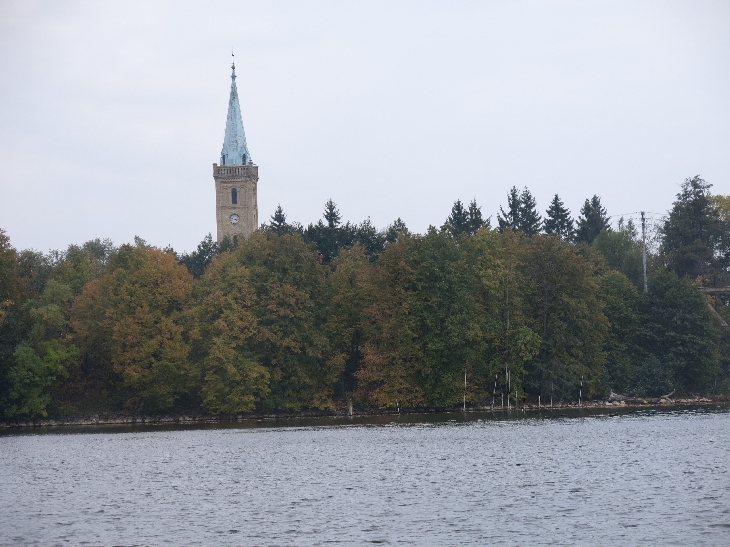 Church tower and Autumn colours at Mikolajki © Sybille Yates