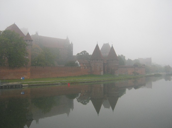 Malbork Castle reflected in the Nogat river © Ricky Yates