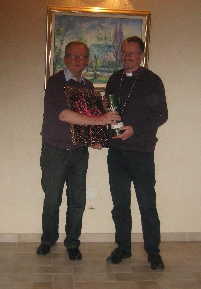 Bishop Robert making a presentation to retiring Archdeacon Patrick Curran © Ricky Yates