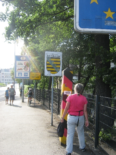 Sybille examoining the border marker as we walked back into Germany © Ricky Yates