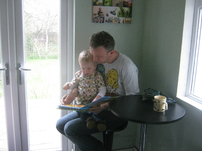 Ian reading Finley's new book to him © Ricky Yates