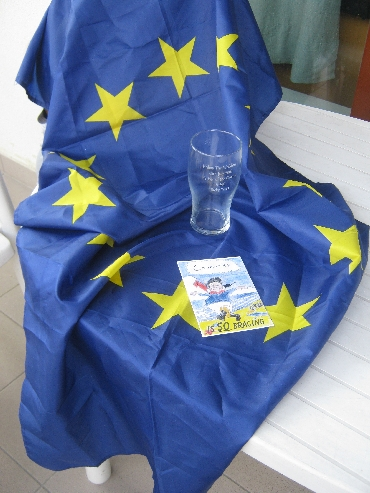 My postcard & inscribed beer glass, together with the EU flag © Ricky Yates